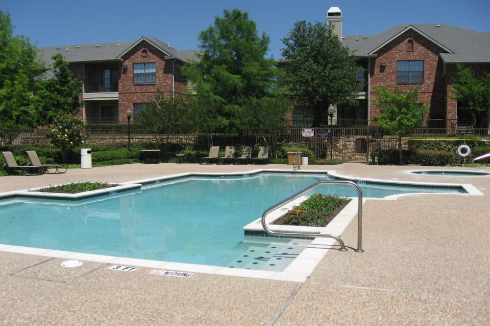 Modern swimming pool at The Abbey at Hightower in North Richland Hills, TX