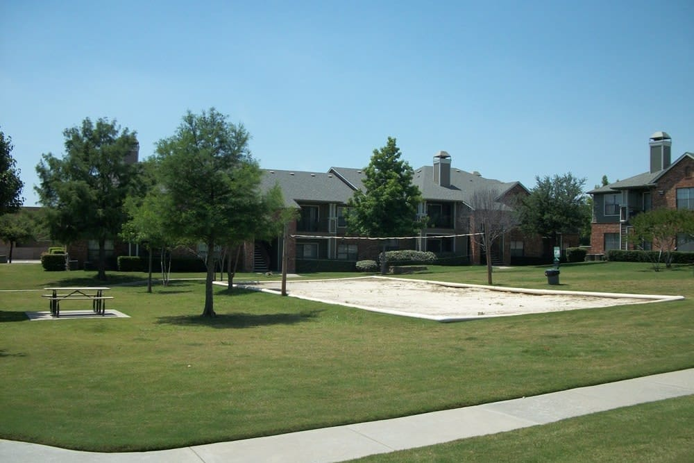 A volleyball court that is great for entertaining at The Abbey at Hightower in North Richland Hills, TX