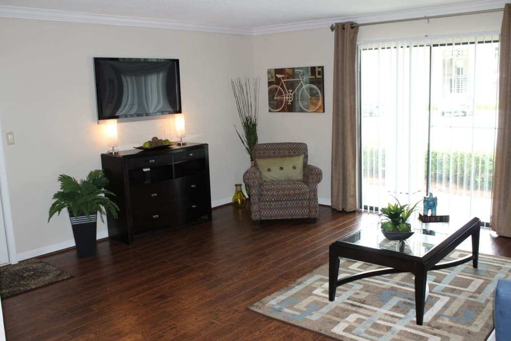 Spacious living room at The Abbey at Riverchase apartments in Hoover, AL