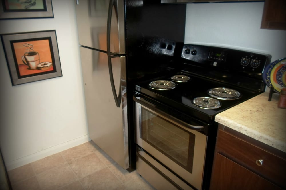 Fully equipped kitchen at The Abbey at Willowbrook apartments