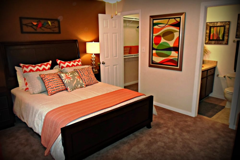 Enjoy a cozy bedroom at The Abbey at Willowbrook apartments in Houston, TX