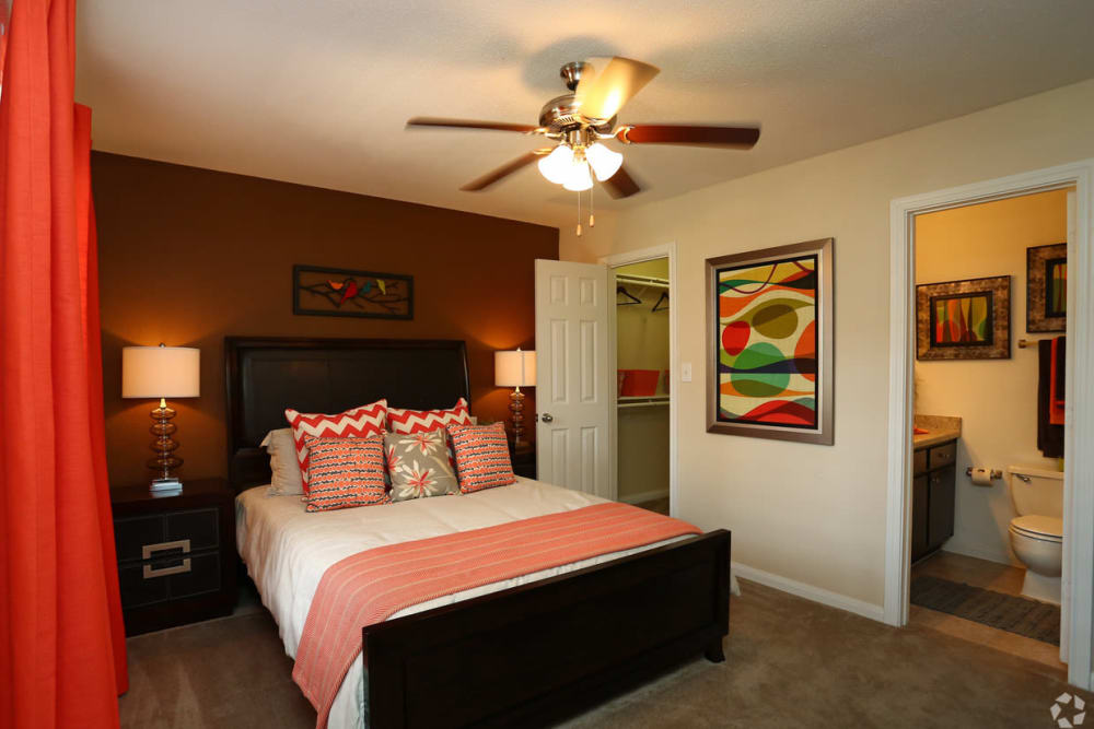 Well decorated bedroom at The Abbey at Willowbrook apartments