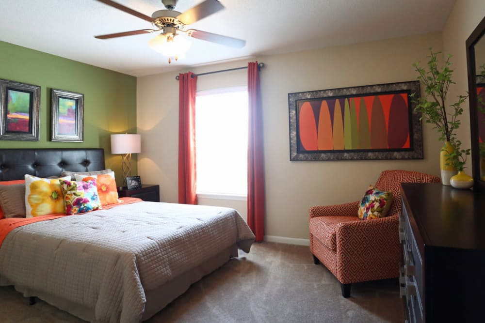 Cozy bedroom at The Abbey at Conroe apartments in Conroe, TX
