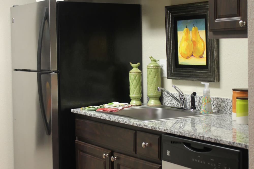 Well-equipped kitchen at The Abbey at Conroe apartments in Conroe