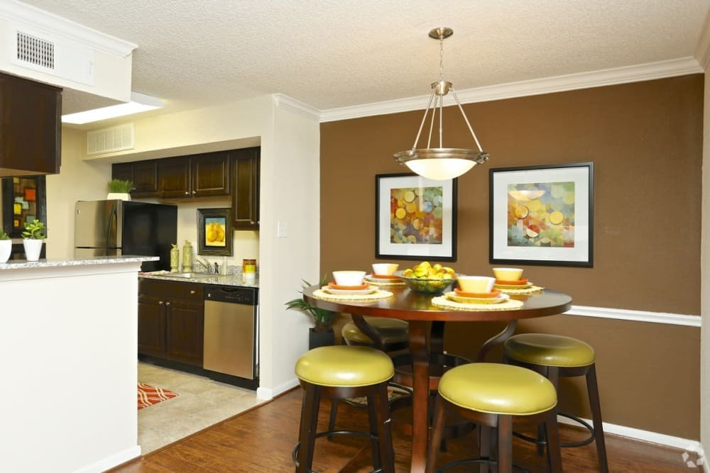 Kitchen and dining area at The Abbey at Montgomery Park apartments