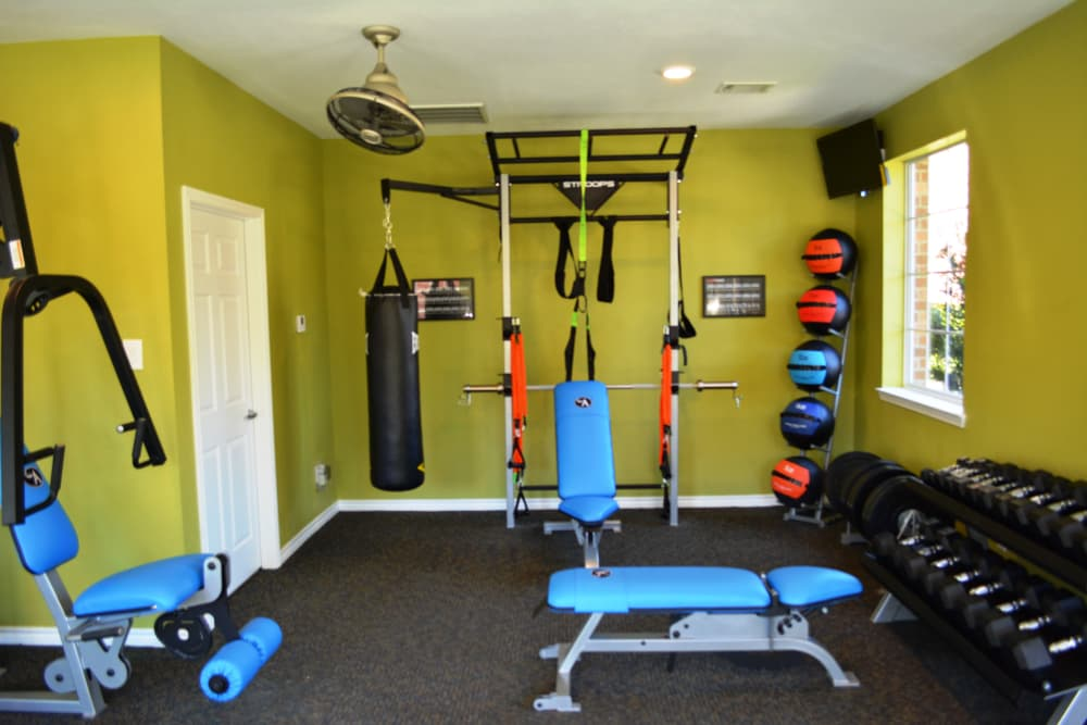 Fitness center at The Abbey at Montgomery Park in Conroe, TX