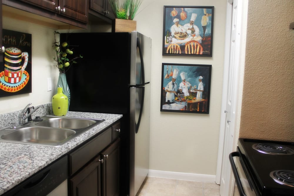 Well-equipped kitchen at The Abbey at Montgomery Park apartments in Conroe