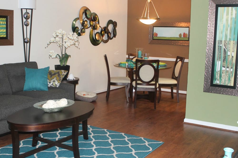 Dining area and living room  at The Abbey at Montgomery Park apartments