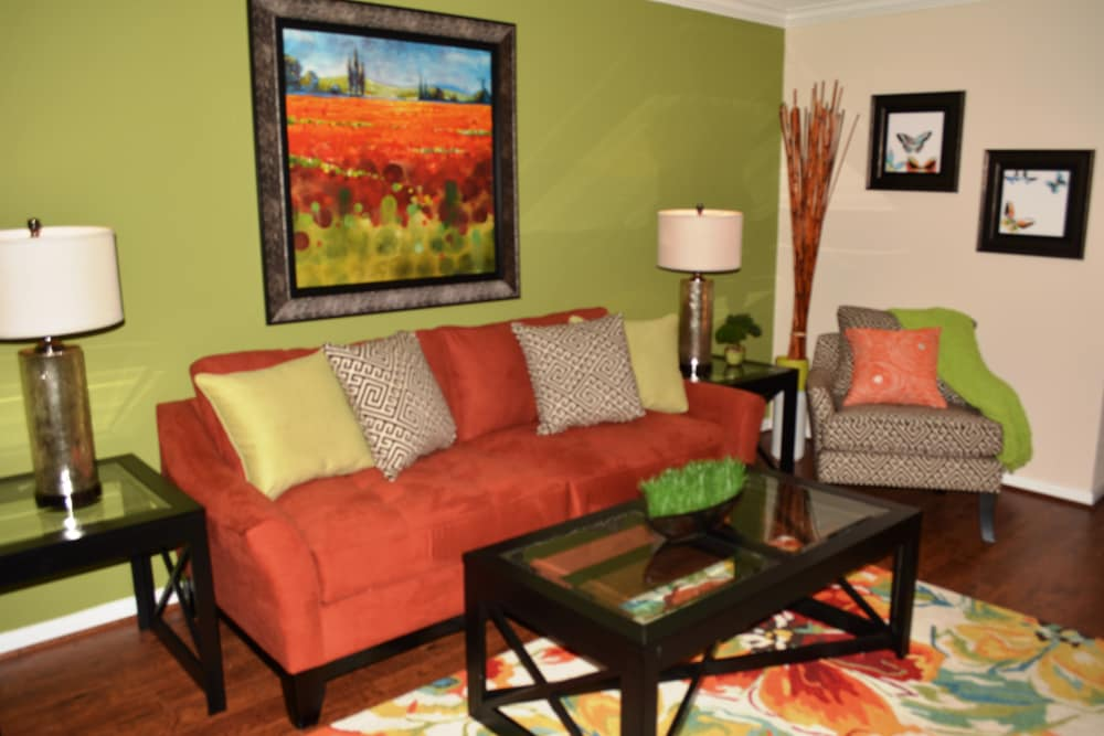 Spacious living room at The Abbey at Montgomery Park apartments in Conroe, TX