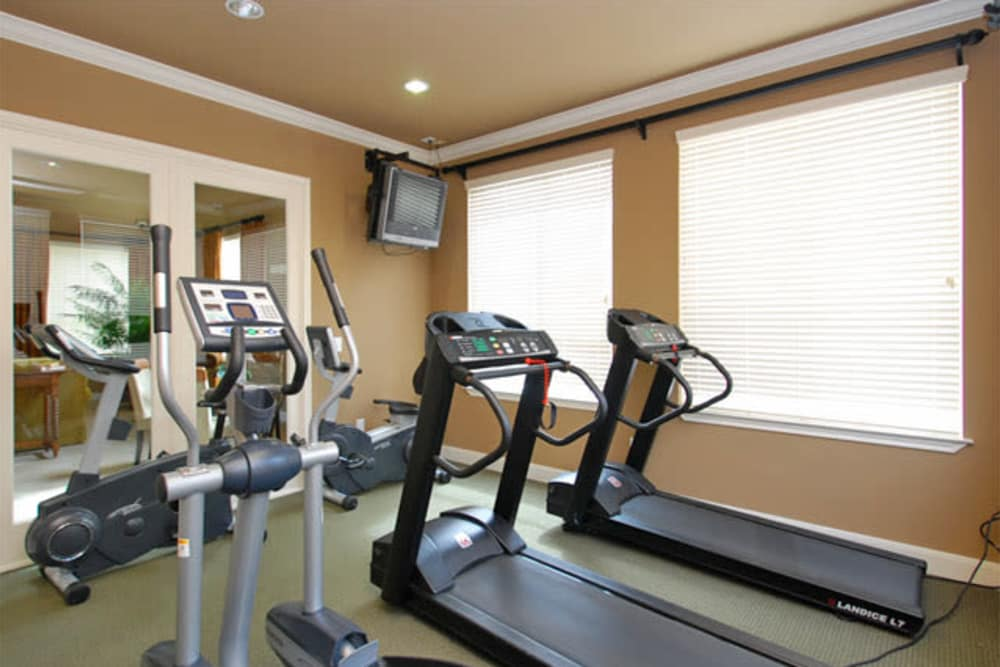 Modern fitness center at The Abbey at Briar Forest in Houston, TX
