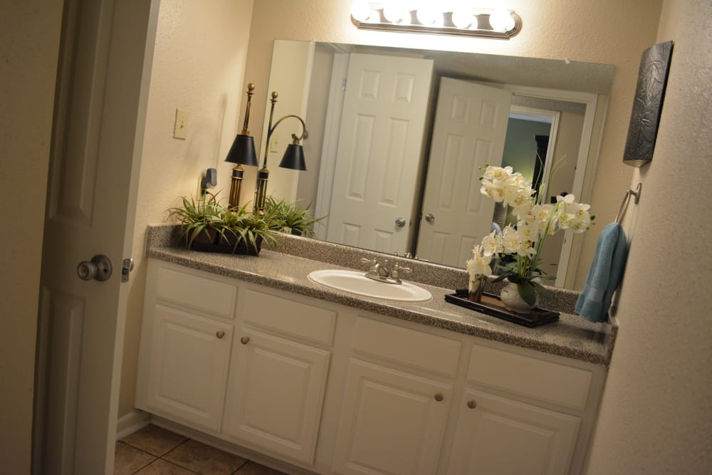 Bathroom with mirror at The Abbey at Briargrove Park in Houston, TX