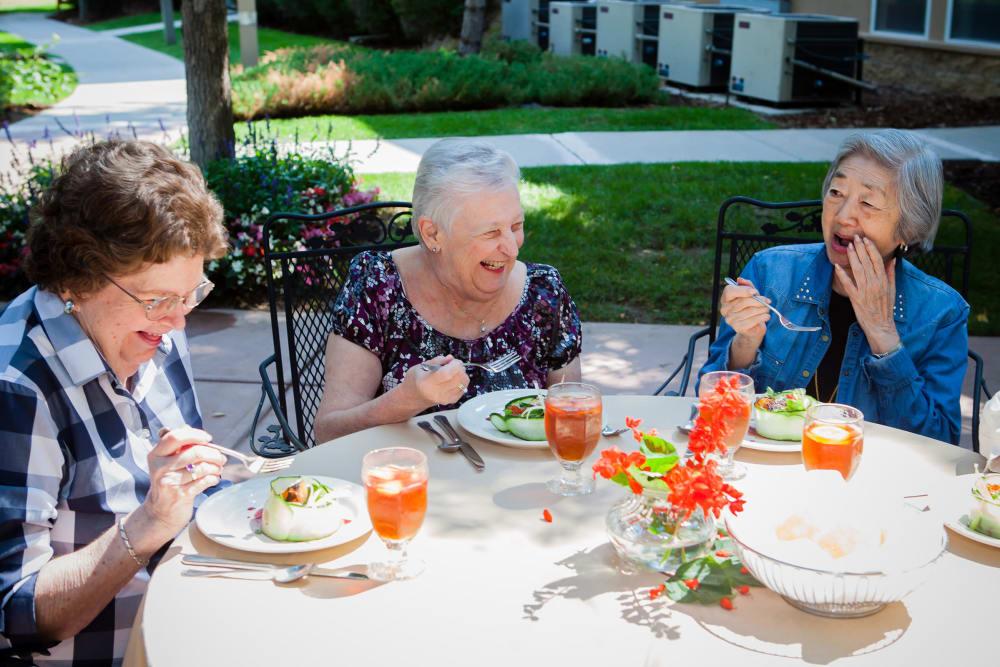 Friends enjoy an outdoor dinner at Someren Glen