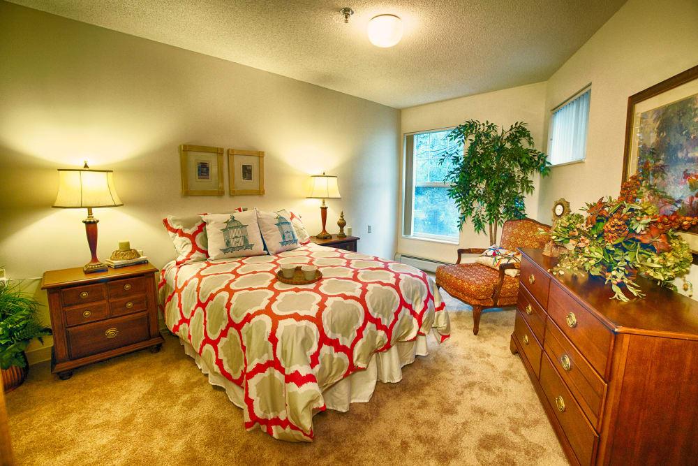 A model bedroom with nice lighting at Someren Glen