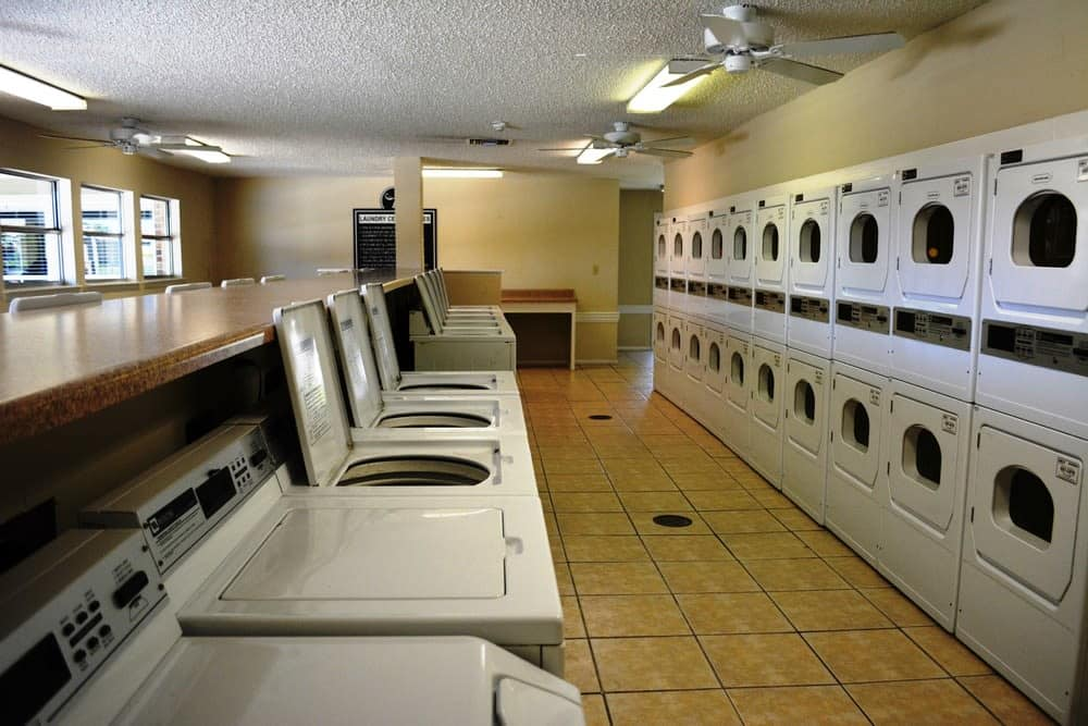 Laundry facility at The Abbey at Northlake apartments