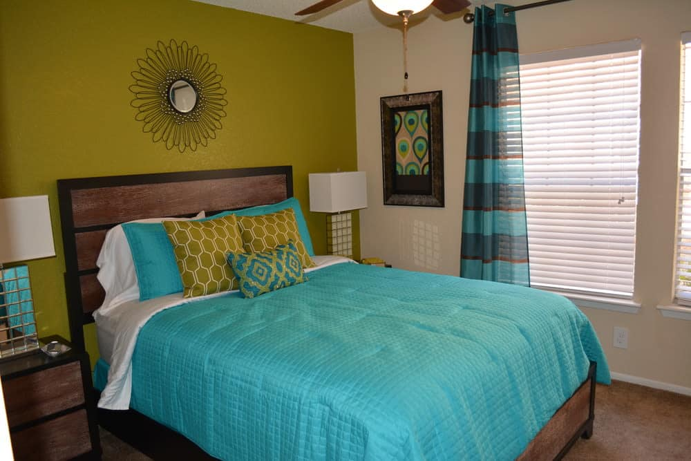 Enjoy a cozy bedroom at The Abbey at Northlake apartments