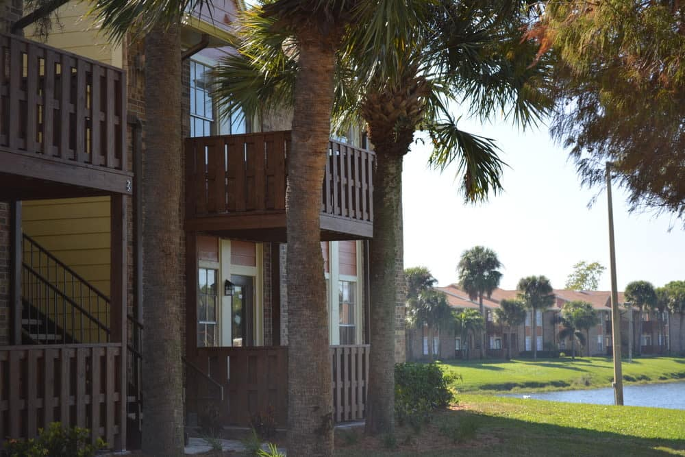 Apartments and lake view at The Abbey at Northlake in Riviera Beach, FL