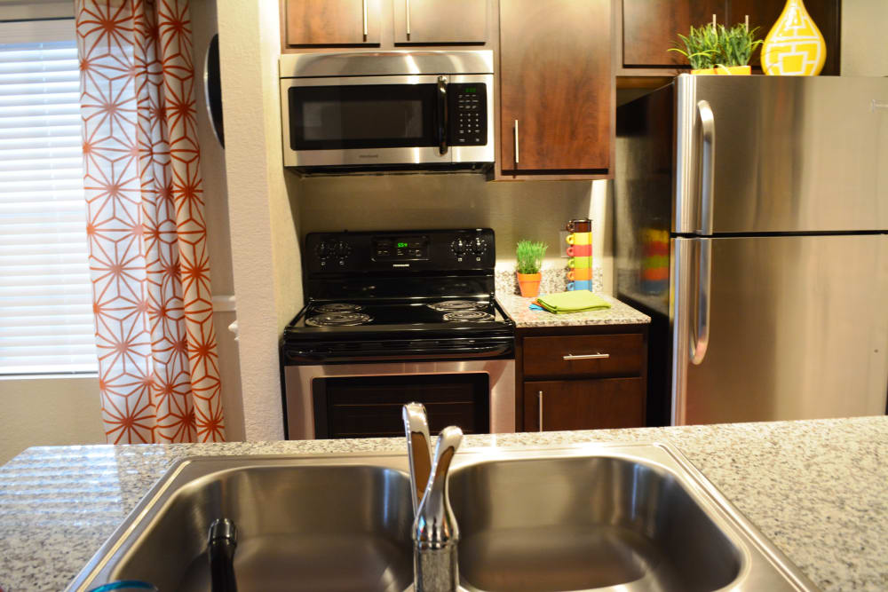 Modern kitchen at The Abbey at Copper Creek apartments