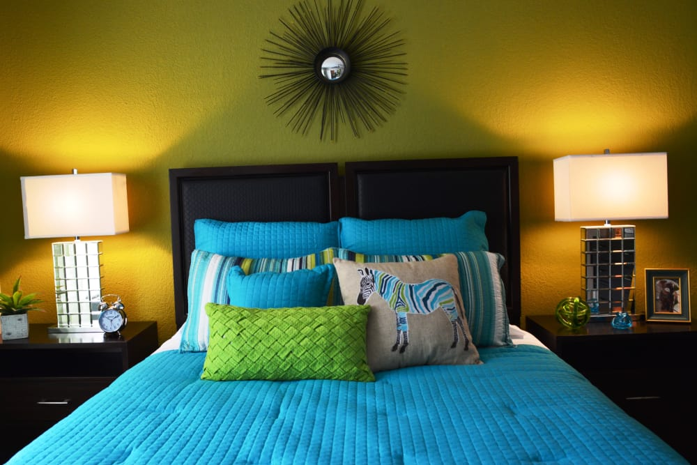 Comfy bed at The Abbey at Copper Creek apartments in San Antonio