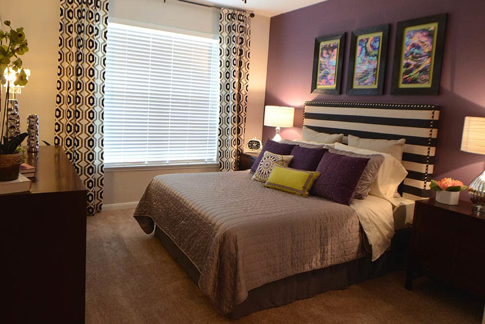 Well-decorated bedroom at The Abbey at Grant Road apartments