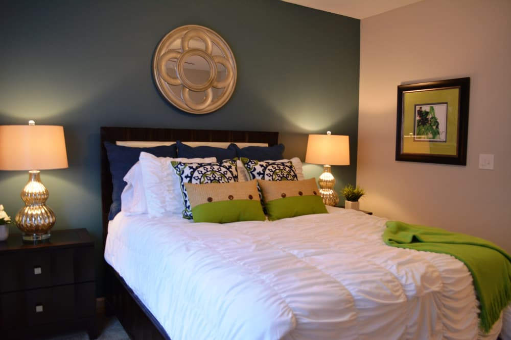 Comfy bed at The Abbey at Eagles Landing apartments in Stockbridge