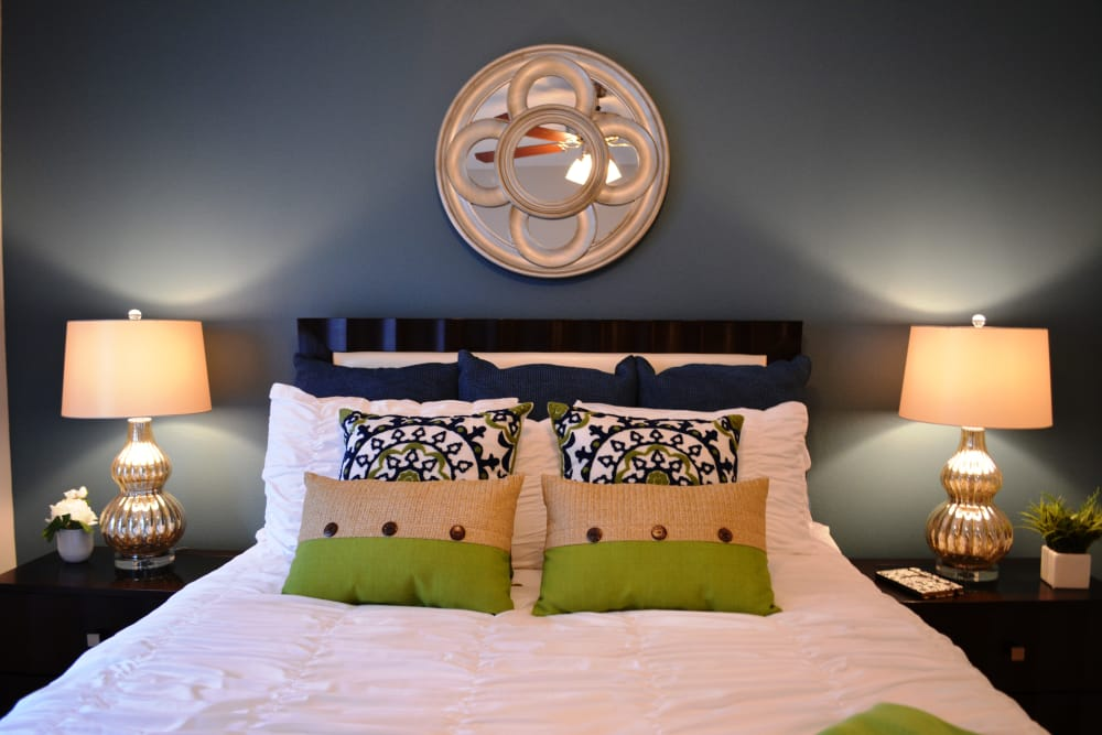 Cozy bedroom at The Abbey at Eagles Landing apartments in Stockbridge