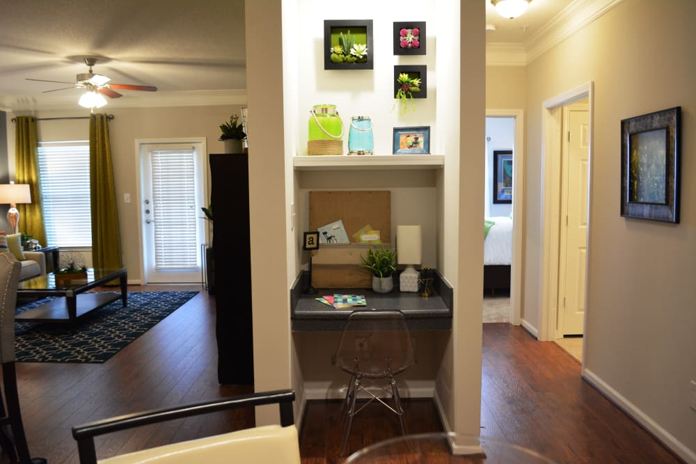 Living room and desk view at The Abbey at Eagles Landing apartments in Stockbridge