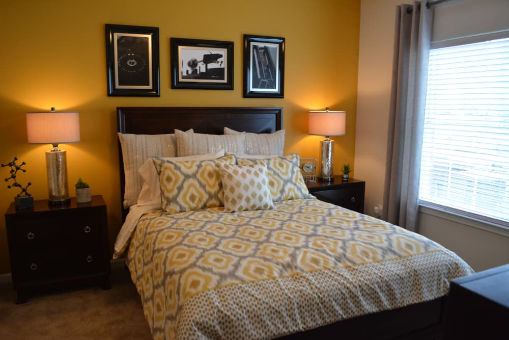Well-decorated bedroom at The Abbey at Eagles Landing apartments in Stockbridge