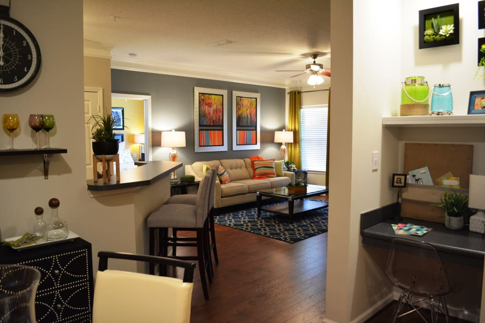 Living room and dining area view at The Abbey at Eagles Landing apartments