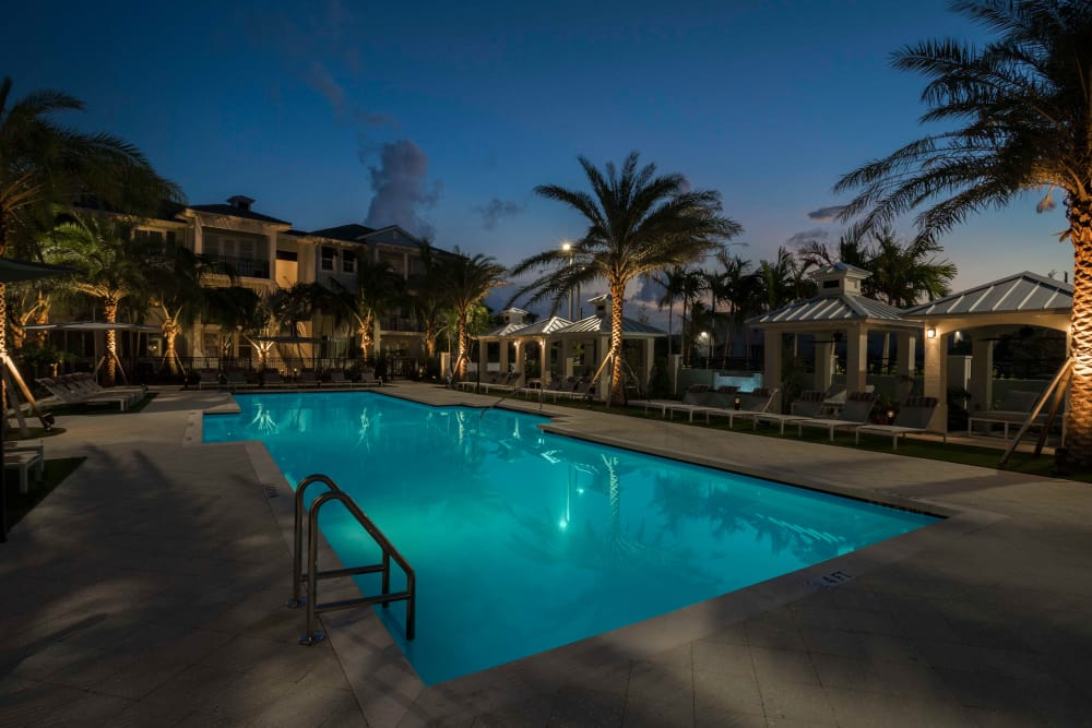 Night view of the spectacular swimming area at Delray Station in Delray Beach, Florida