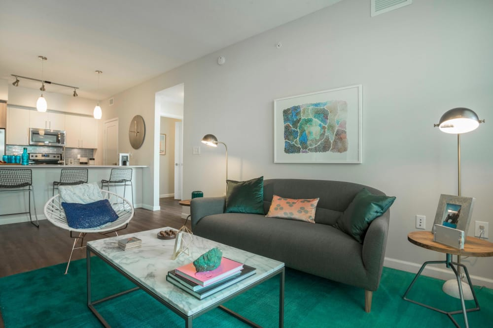 Model living room featuring teal decor at Delray Station in Delray Beach, Florida