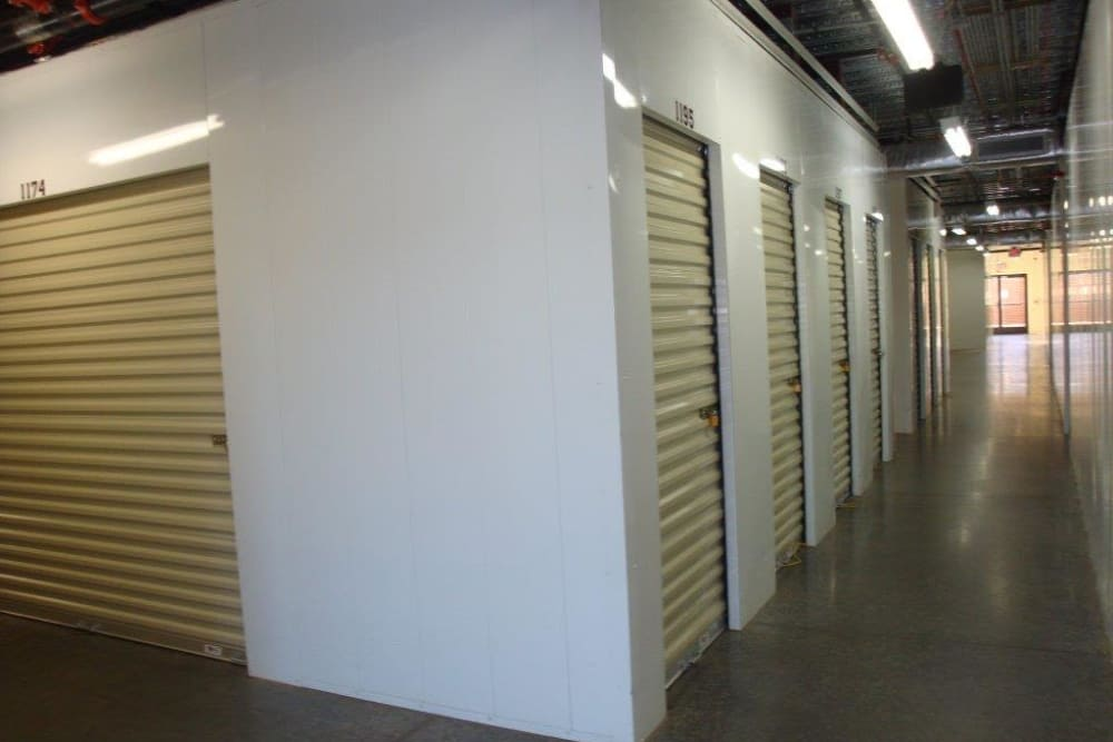 Well-lit interior hallways at Budget Mini Storage