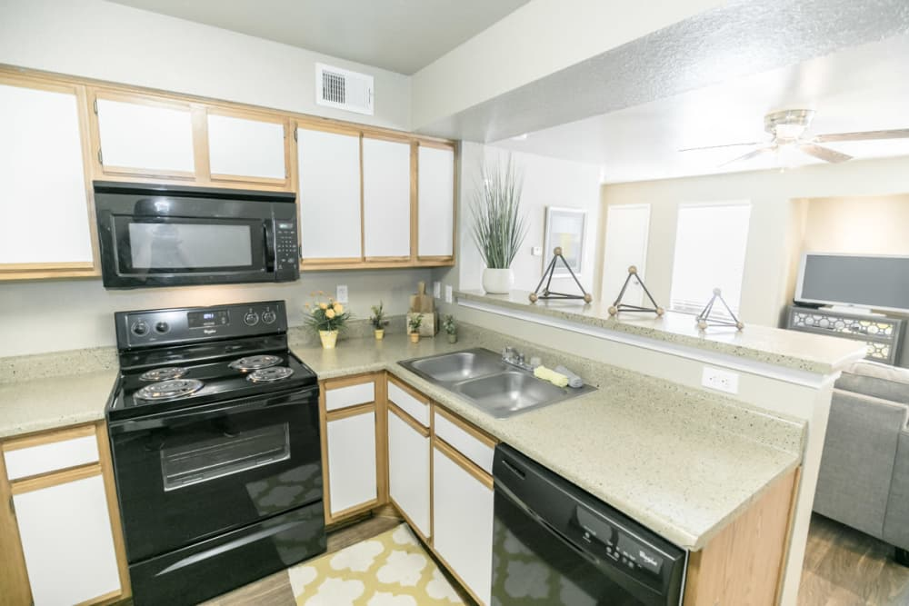 89 East apartments showcase a fully equipped kitchen in Tulsa