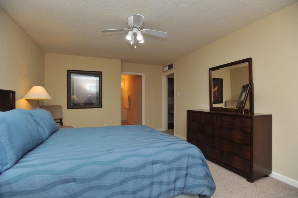 Cozy bedroom at Pear Tree apartments in El Paso