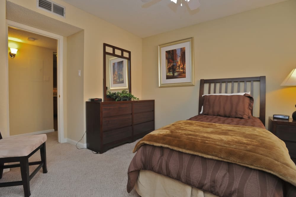 Well decorated bedroom at Pear Tree apartments in El Paso