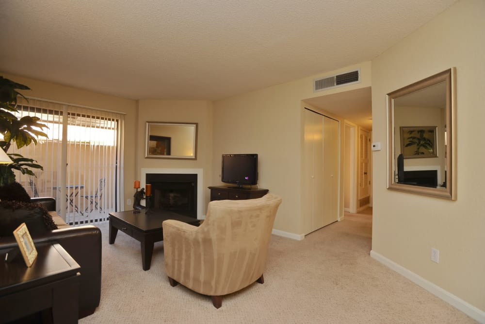 Living room and fireplace at Pear Tree apartments