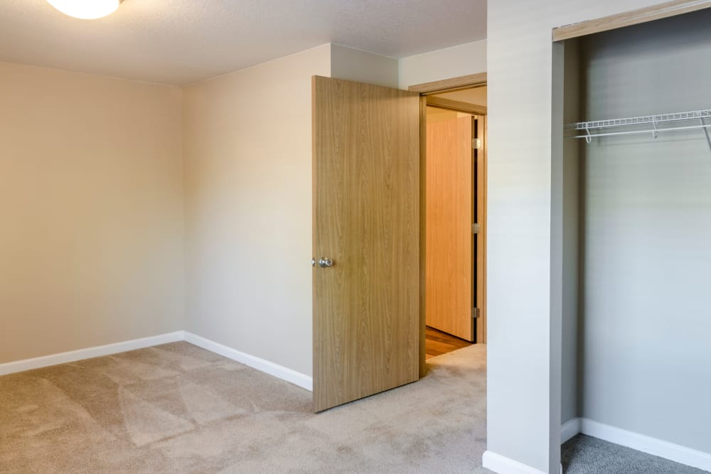 Bedrooms with closet at Madison Park Apartments in Vancouver, Washington