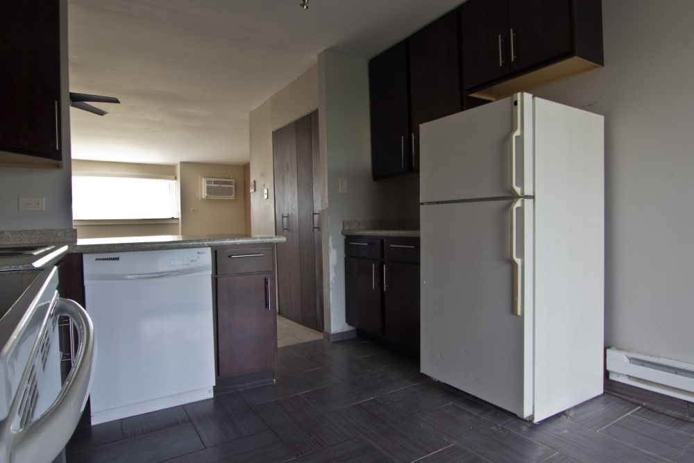 Kitchen with appliances at The Flats at Gladstone