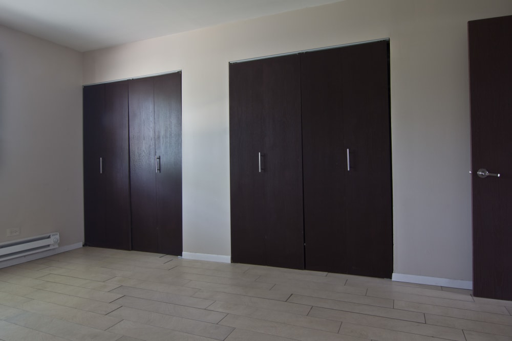 Bedroom with plenty of storage at The Flats at Gladstone