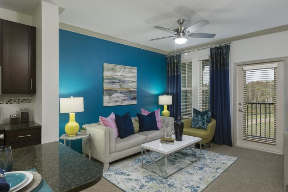 Inviting living room at Integra 360 Apartment Homes in Winter Springs, FL