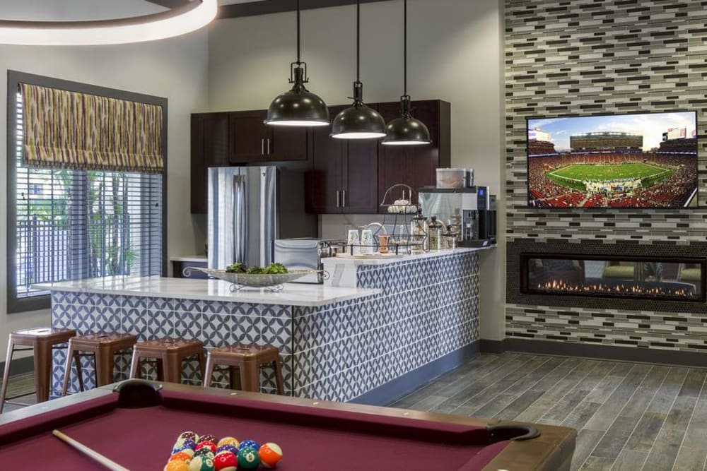 Clubhouse kitchen at Integra 360 Apartment Homes in Winter Springs, FL