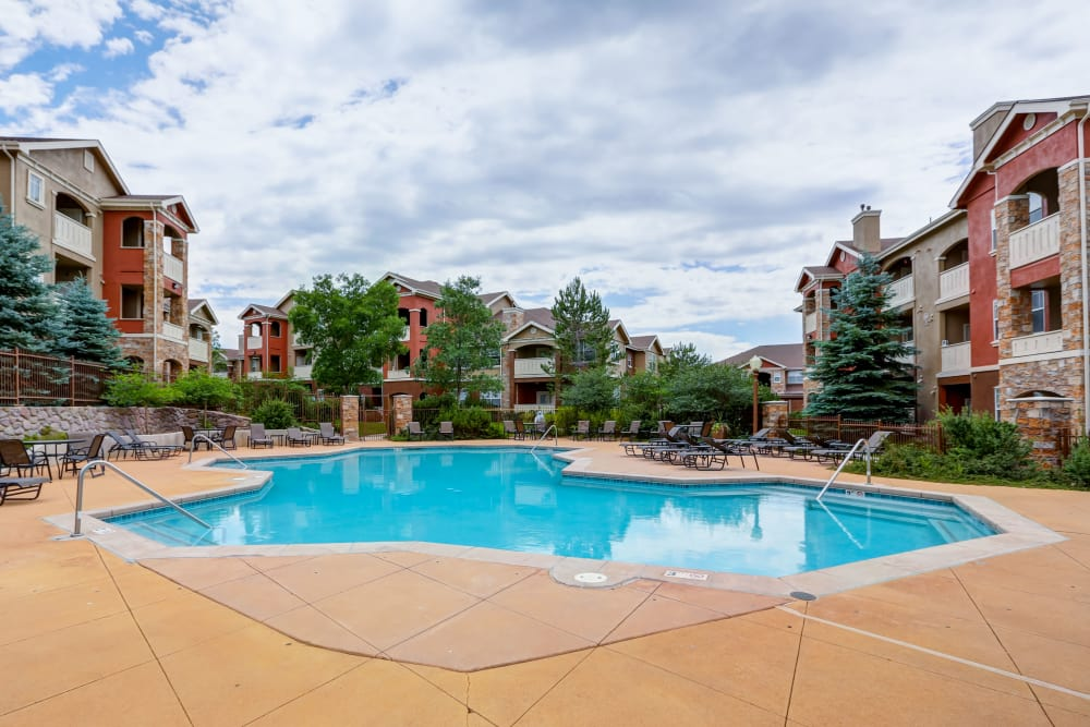 Bella Springs Apartments offers a spacious swimming pool in Colorado Springs, Colorado