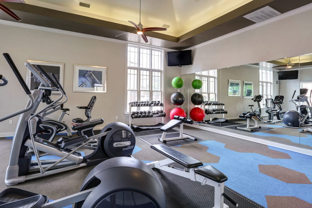 Enjoy apartments with a modern fitness center at Bella Springs Apartments