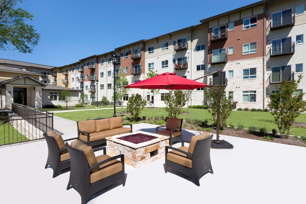Affinity at Wells Branch homes with a view of the fire-pit