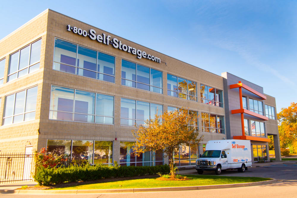 Another view of 1-800-SELF-STORAGE.com exterior featuring moving truck in Troy, Michigan