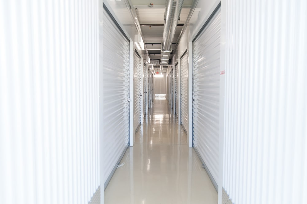 Another view of a hallway featuring storage units at 1-800-SELF-STORAGE.com in Troy, Michigan
