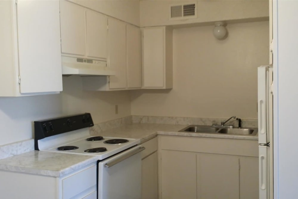 A view of the kitchen at Charleston Apartments in Norman
