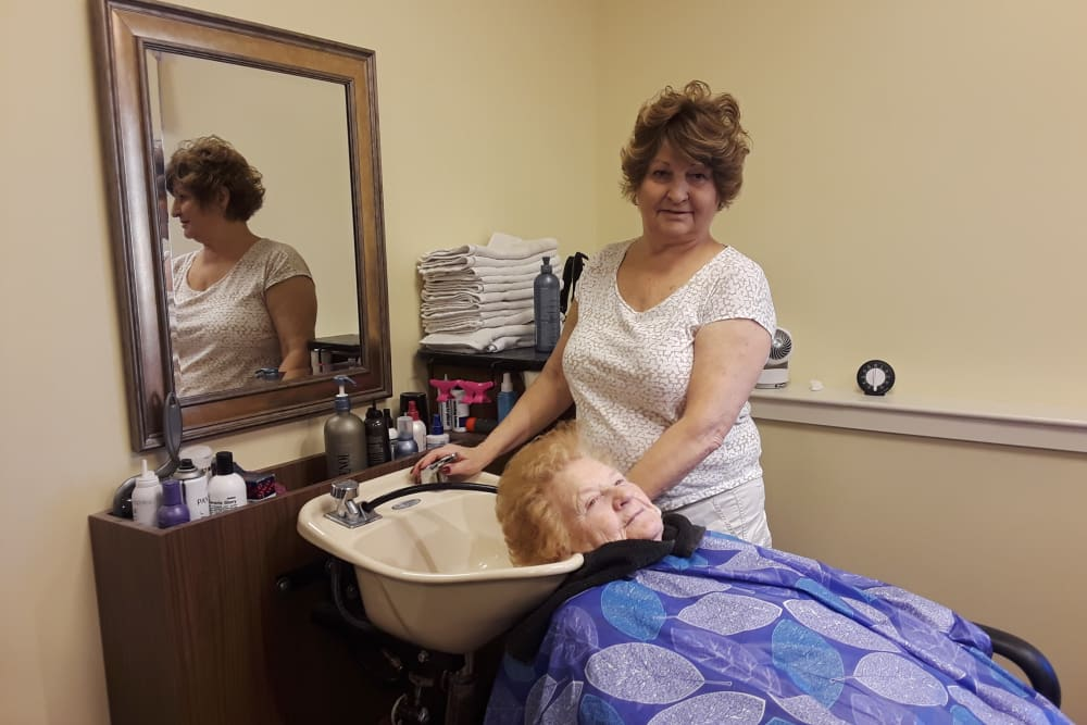 Resident in our beauty salon at Eastern Star Masonic Retirement Campus in Denver, CO
