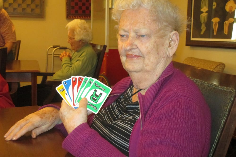 Resident playing cards at Eastern Star Masonic Retirement Campus in Denver, CO