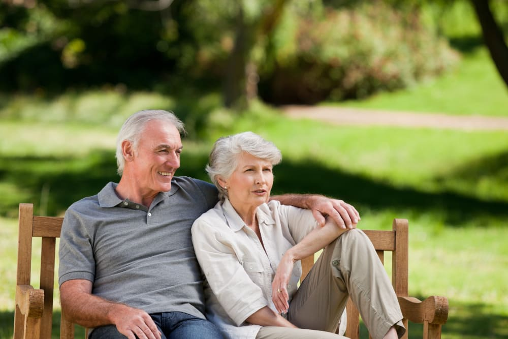 Couple in bench at our senior living facility in Town & Country, Missouri