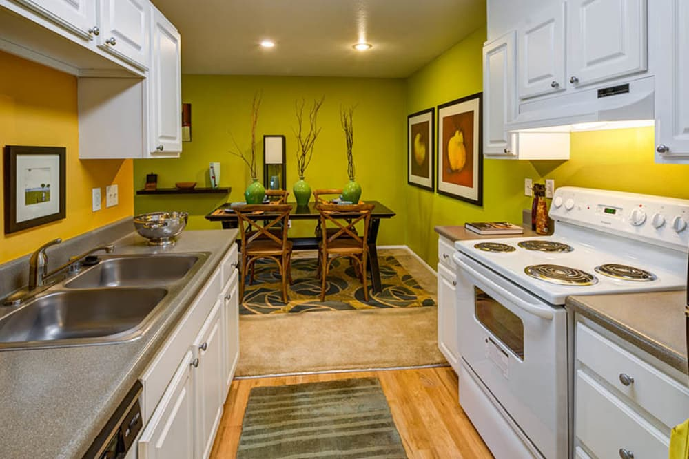 Beautiful kitchen and dining room at Walden Pond Apartments in Everett, Washington